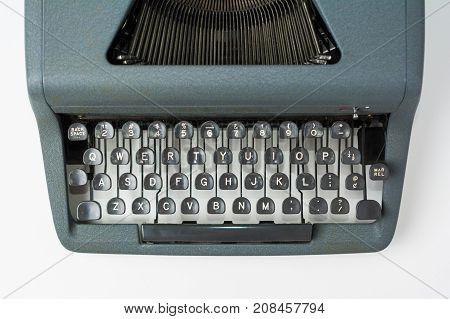 Antique Typewriter on White Background Close Up on Keys