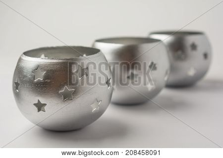Tealight Candles with Stars on White Background Side View