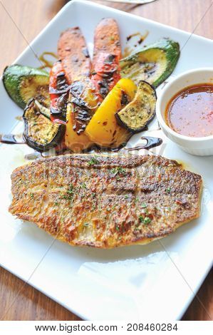 close up Grilled fish cutlet with grill vegetables