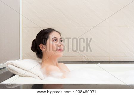 Lady Lying Down In Bathtub And Looking At Air