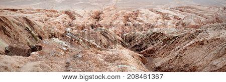 The Flaming Mountains, barren, eroded, red sandstone hills in Tian Shan Mountain range in Xinjiang Uighur Autonomous Region of China.