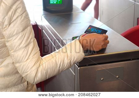 SYDNEY - August 12 2017:Opal Card User. Opal is a contactless smartcard ticketing system for public transport services.Opal card used by train passenger when tapping on and off at the Opal card reader in Sydney's railway station.
