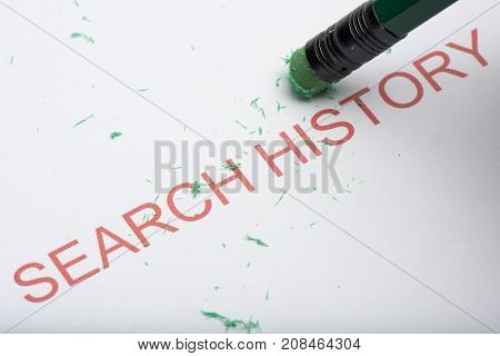 Pencil Erasing The Word 'search History' On Paper