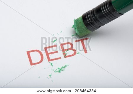 Pencil Eraser Trying To Remove The Word 'debt' On Paper