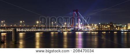Willemsbrug Bridge and river Meuse Rotterdam The Netherlands: night Long wide banner