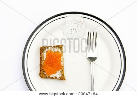 Rye bread with red caviar on a plate