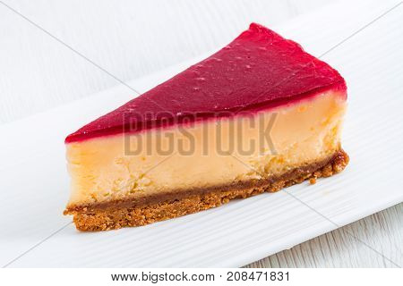 a delicious strawberry cheesecake on white dish