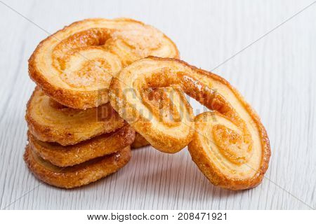 some butter biscuit on white wooden background