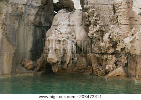 Lion statue on the Fountain of the Four Rivers (Fontana dei Quattro Fiumi) in the Piazza Navona in Rome, Italy