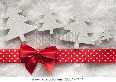 Wooden Christmas Trees, Red Bow And Ribbon On Snow