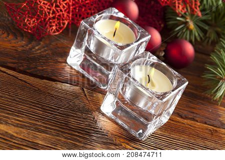 Candles, Baubles And Branch Of Spruce Tree