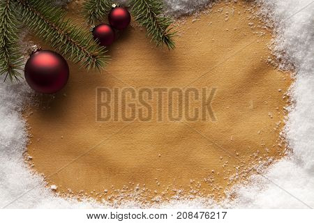 Christmas background - spruce tree, baubles and snow on handmade paper sheet