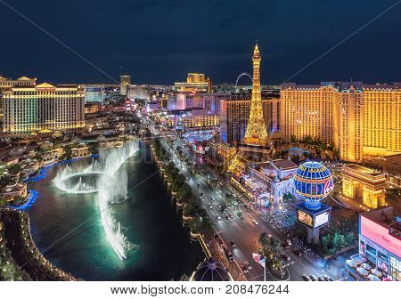 Las Vegas skyline, Aerial view at night on July 25, 2017 in Las Vegas, Nevada. Caesars Palace, the Flamingo and Paris Hotel and casino are in the background.