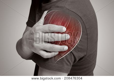Closeup of young shirtless man with shoulder pain Upper arm pain People with body-muscles problem Healthcare And Medicine concept
