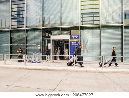 FRANKFURT GERMANY - AUG 1 2017: Young female and male passengers arriving with luggage at Frankfurt airport from Frankfurt airport long-distance train station