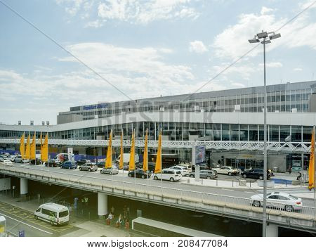 FRANKFURT GERMANY - AUG 1 2017: Cars dropping off and picking up passengers at Frankfurt airport departures and arrivals seen from the Squaire office building Lufthansa