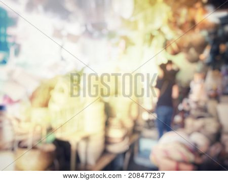 Blurred Image Of Business Woman Shopping For Straw Bags, Basketwork, Wicker Baskets Handmade In Loca