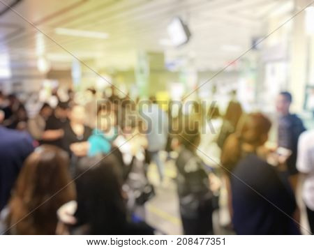 Blurred Image Of Asian People On The Queue Line On Rush Hour Waiting For Train Subway Station. Stay