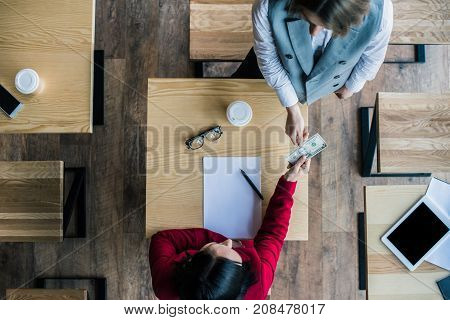 Woman Paying In Cafe