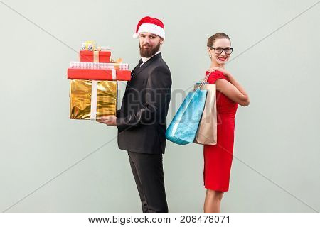 Back To Back. Profile View Man In Red Hat And Woman In Red Dress And Glasses. Happiness Couple Holdi