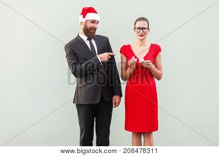 Sneer And Mock Concept. Man Pointing Fingers At Woman And Smiling. Woman Crying And Holding Bad Gift