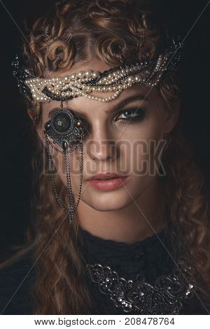 Queen Of Darkness In Black Fantasy Costume On Dark Gothic Background. High Fashion Beauty Model With