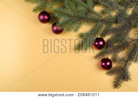 Christmas Fir Tree With Decoration On Golden Background, Free Space. Christmas Or New Year Backgroun