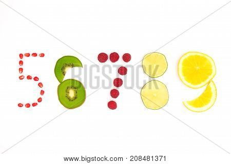 Numbers From Five To Nine Made Of Fruit And Berries On White Background
