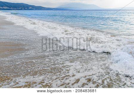 Beach and beautiful foam wave sea background