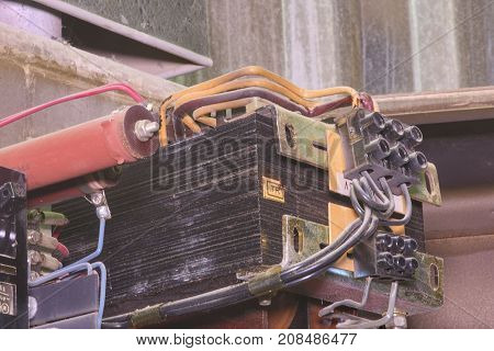 Old Transformer Inside Electric Distribution Case. Closeup.