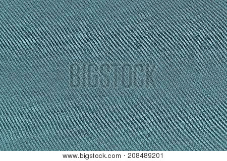 blue background of texture of knitted material or plexus fabric closeup