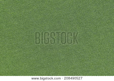 green background of texture of knitted material or plexus fabric closeup