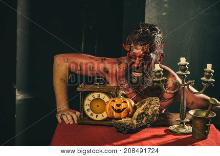 Halloween Man With Pumpkin, Clock, Candlestick On Table