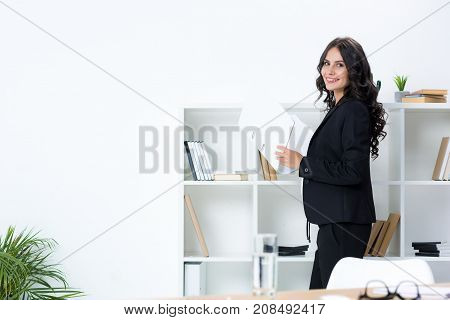 Businesswoman With Documents Folder