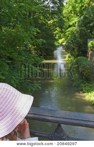 Girl admiring a river canal