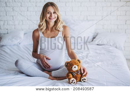 Pregnant In Bed