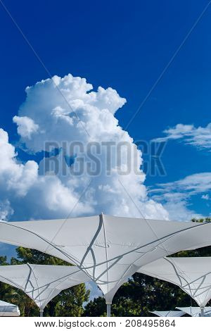 The summer sunshade is filled with clouds.
