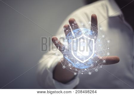 Business, Technology, Internet and network concept. Young businessman working in the field of the future, he sees the inscription: network security
