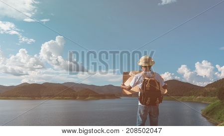Young traveler hiking a map looking for direction