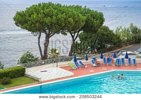 People Resting Near Swimming Pool. Ischia, Italy