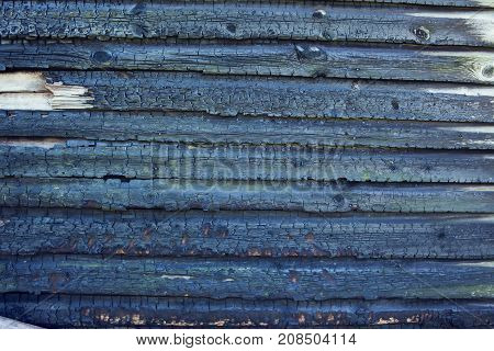 Old burned wooden wall board background texture