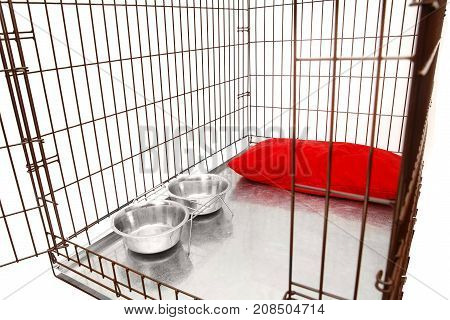 Dog no one in cage. Isolated background.