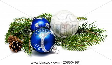 Christmas decoration blue and silver balls with fir cones and fir tree branches isolated on a white background
