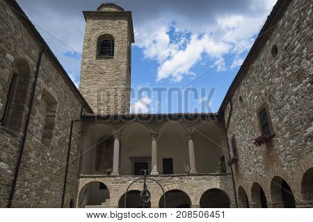 CARPEGNA, ITALY - JULY 4, 2017: The medieval church (pieve) of San Giovanni Battista at Carpegna (Montefeltro Pesaro Urbino Marches Italy). Cloister