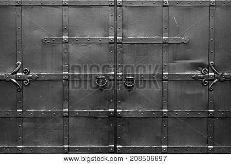 Steel black gates. Symmetrical and isolated. Abstract black and white background with correct geometric proportions.