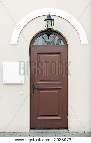 Old entrance doors with blank signage to add text