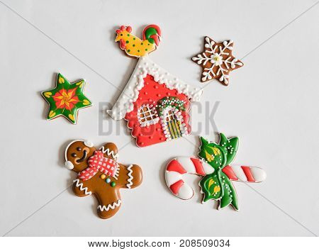 Christmas homemade gingerbread cookies on new year gift isolated on white background isolate. man, house, candy