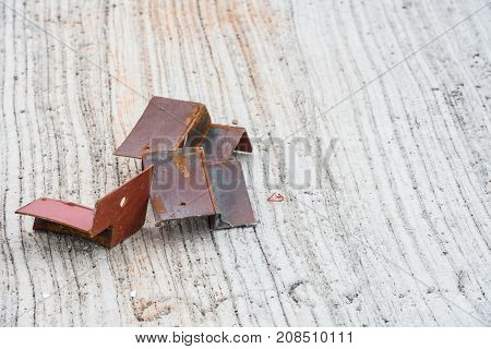 Several pieces of scrap iron rods placed on the concrete floor.