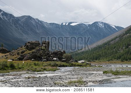 Wildlife Altai. The river mountains and blue sky with clouds in summer