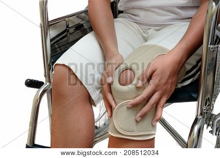 Injuried Woman With Knee Pain Sitting On Wheelchair